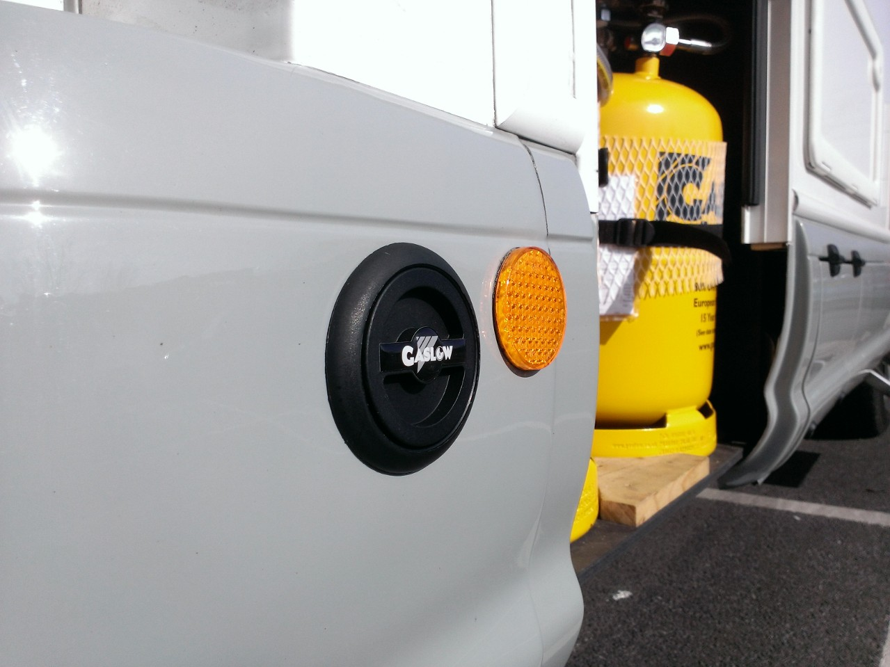 Gaslow filling kit mounted on side of motorhome